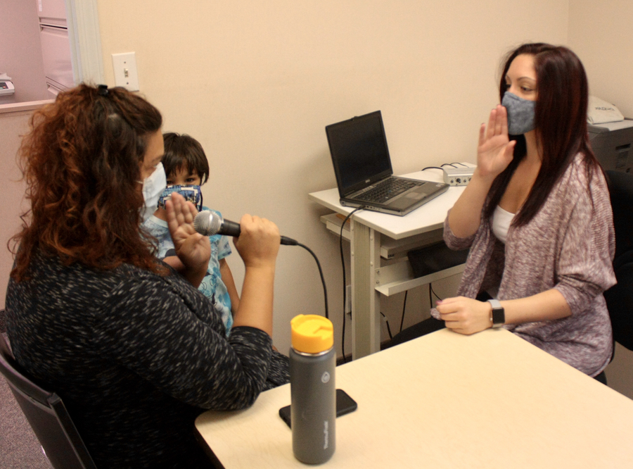 Melissa with voice disorder client